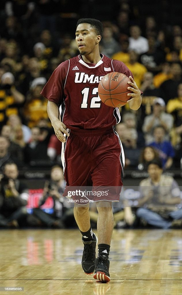 Trey Davis #12 of the UMass Minutemen brings the ball upcourt against the VCU Rams in the second half during the Atlantic 10 Basketball Tournament - Semifinals at the Barclays Center on March 16, 2013 in the Brooklyn borough of New York City.