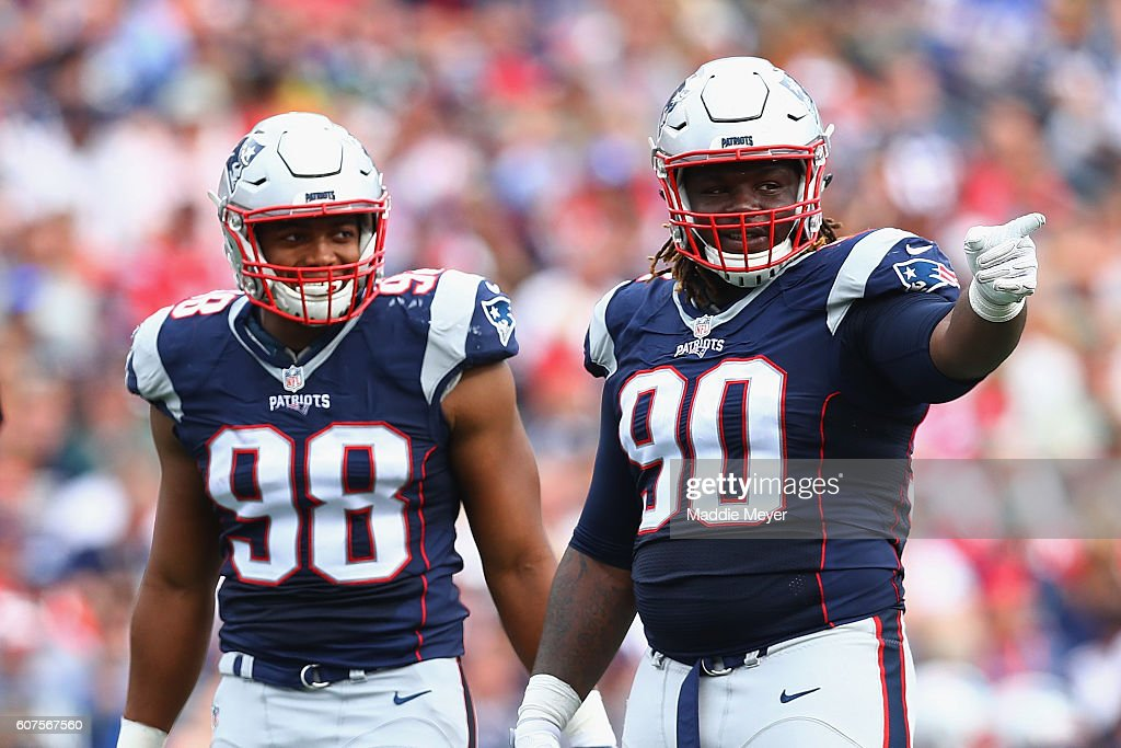 fa8b3693d ... Flowers 98 and Malcom Brown 90 of the New England Patriots react during  Youth Nike New England Patriots 98 Trey Flowers Limited Navy Blue Team Color  ...