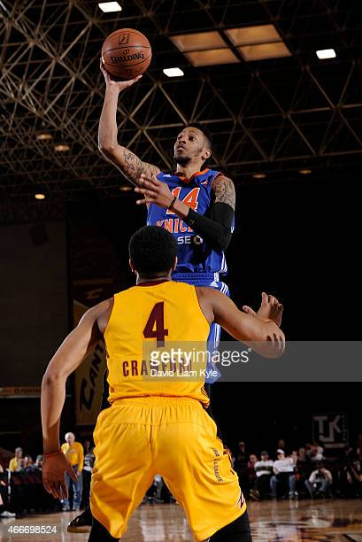 Trey Gilder of the Westchester Knicks goes up for the shot against Chris Crawford of the Canton Charge at the Canton Memorial Civic Center on March...