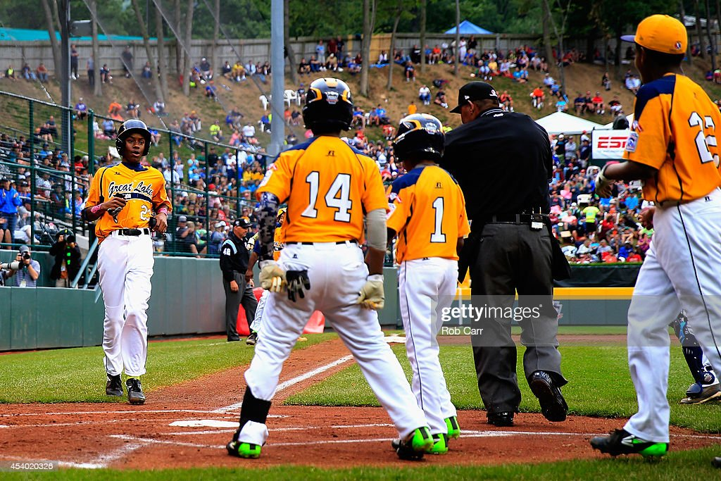 Trey Hondras #24 of the Great Lakes Team from Chicago, Illinois is greeted by teammates after hitting a two RBI home run against the West Team from Las Vegas, Nevada against during the first inning of the United States Championship game of the Little League World Series at Lamade Stadium on August 23, 2014 in South Williamsport, Pennsylvania.