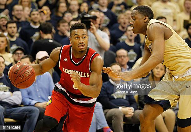 Trey Lewis of the Louisville Cardinals drives the baseline against Chris Jones of the Pittsburgh Panthers during the game at Petersen Events Center...