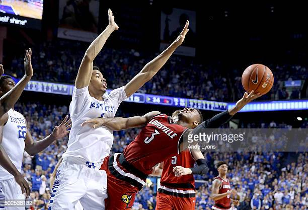Trey Lewis of the Louisville Cardinals shoots the ball while defended by Skal Labissiere of the Kentucky Wildcats at Rupp Arena on December 26 2015...