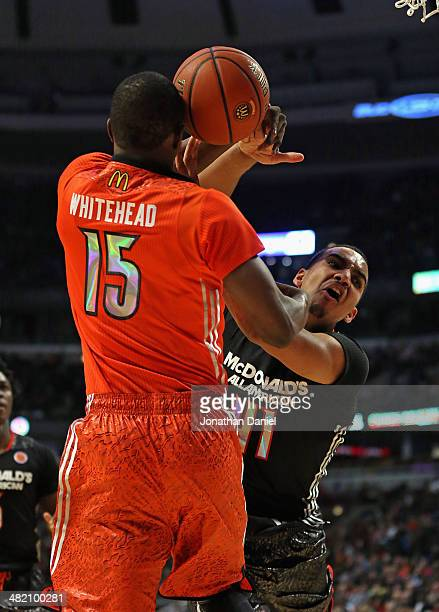Trey Lyles of the west team is fouled by Isaiah Whitehead of the east team during the 2014 McDonald's All American Game at United Center on April 2...