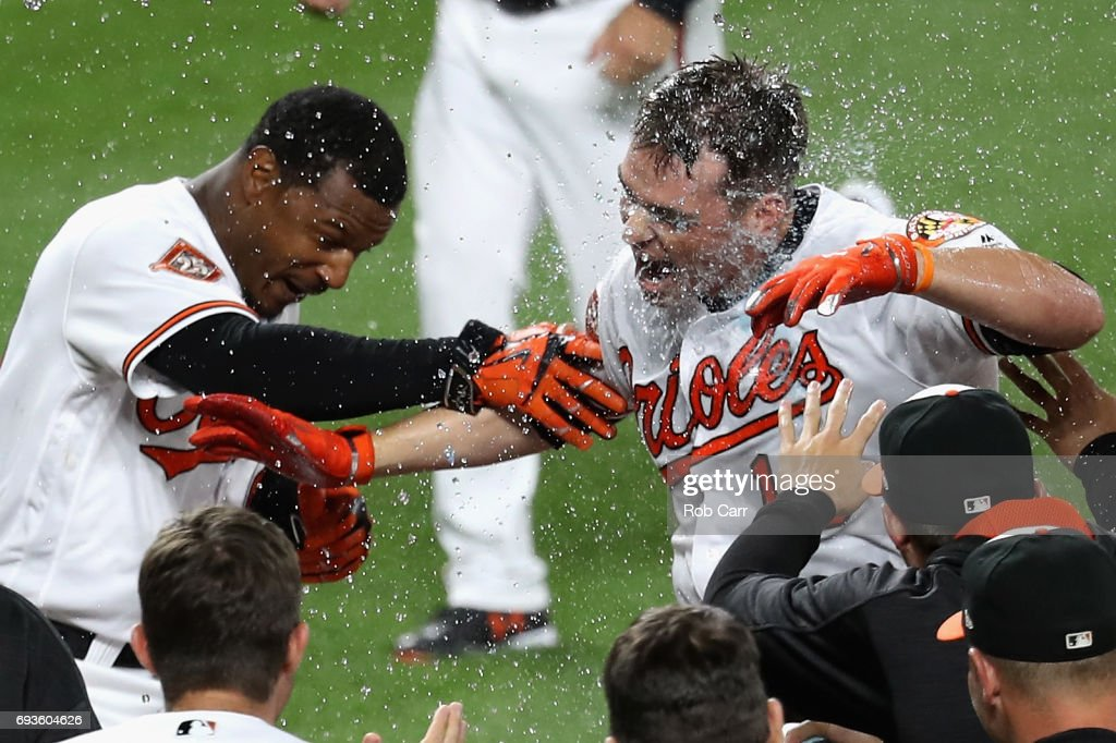 Trey Mancini #16 of the Baltimore Orioles (R) celebrates with Adam Jones #10 at home plate after hitting a walk off three run homer to defeat the Pittsburgh Pirates 9-6 in eleven innings at Oriole Park at Camden Yards on June 7, 2017 in Baltimore, Maryland.