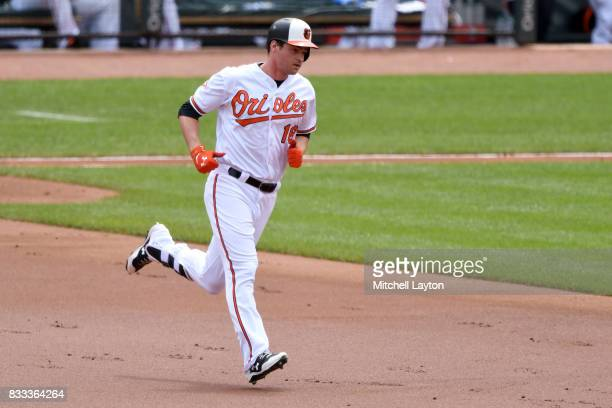 Trey Mancini of the Baltimore Orioles rounds the bases after hitting home run during a baseball game against the Detroit Tigers at Oriole Park at...