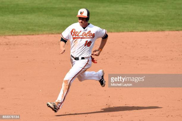 Trey Mancini of the Baltimore Orioles runs to third base during a baseball game against the Detroit Tigers at Oriole Park at Camden Yards on August 6...