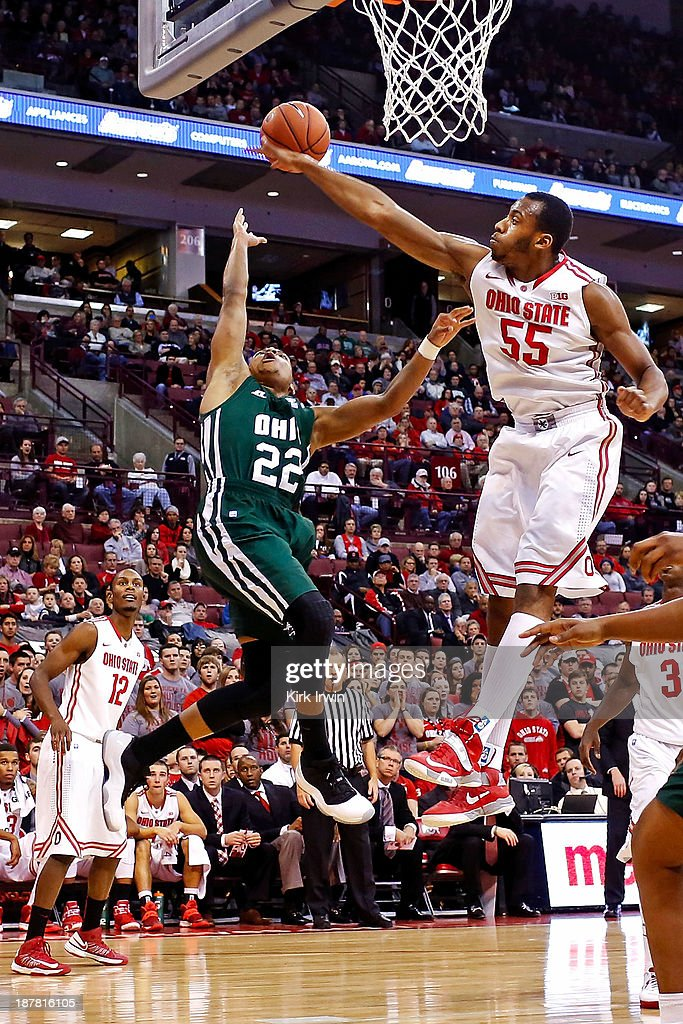 Trey McDonald #55 of the Ohio State Buckeyes blocks a shot from Stevie Taylor #22 of the Ohio Bobcats during the first half at Value City Arena on November 12, 2013 in Columbus, Ohio. Ohio State defeated Ohio 79-69.