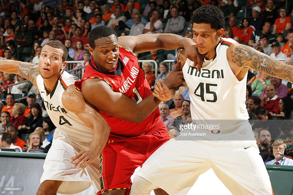 Trey McKinney Jones #4 and Julian Gamble #45 of the Miami Hurricanes battle for position with Charles Mitchell #0 of the Maryland Terrapins during a free throw on January 13, 2013 at the BankUnited Center in Coral Gables, Florida. Miami defeated Maryland 54-47.