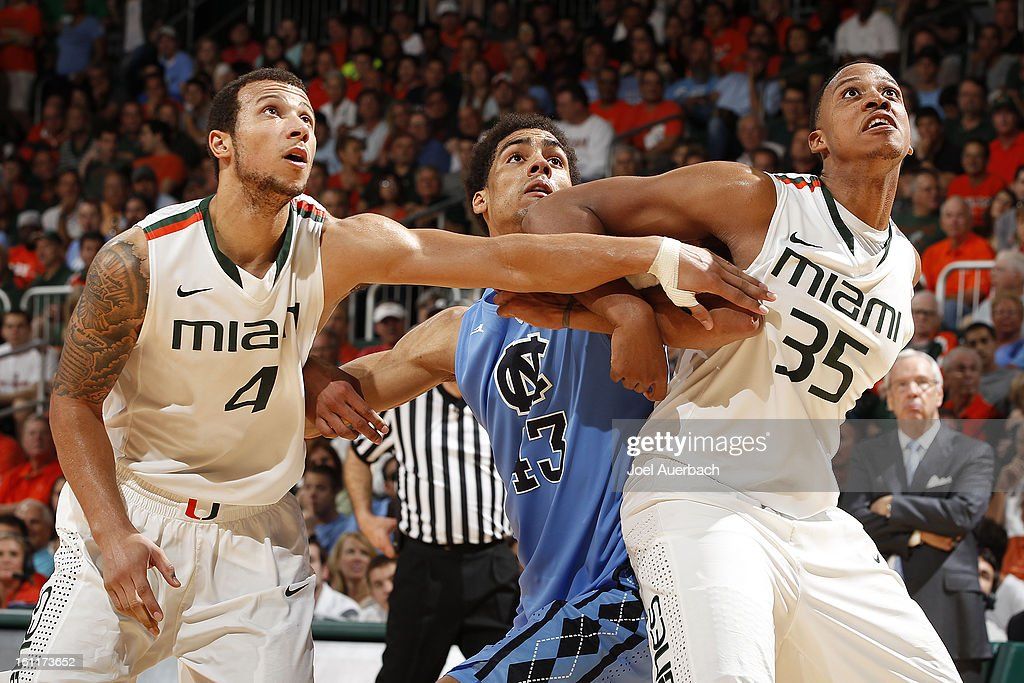 Trey McKinney Jones #4 and Kenny Kadji #35 of the Miami Hurricanes box out James Michael McAdoo #43 of the North Carolina Tar Heels during free throws on February 9, 2013 at the BankUnited Center in Coral Gables, Florida. Miami defeated North Carolina 87-61.