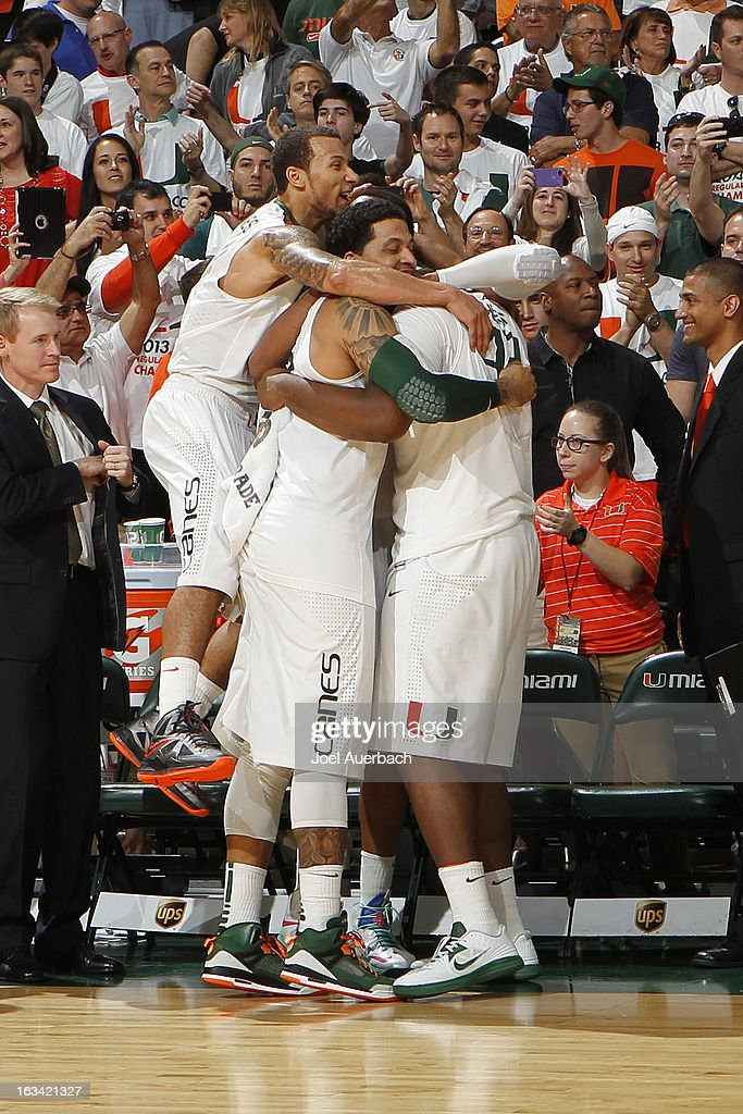 Trey McKinney Jones #4, Julian Gamble #45, and Reggie Johnson #42 of the Miami Hurricanes celebrate their win over the Clemson Tigers on March 9, 2013 at the BankUnited Center in Coral Gables, Florida. The Hurricanes defeated the Tigers 62-49 and won the Atlantic Coast Conference Championship.