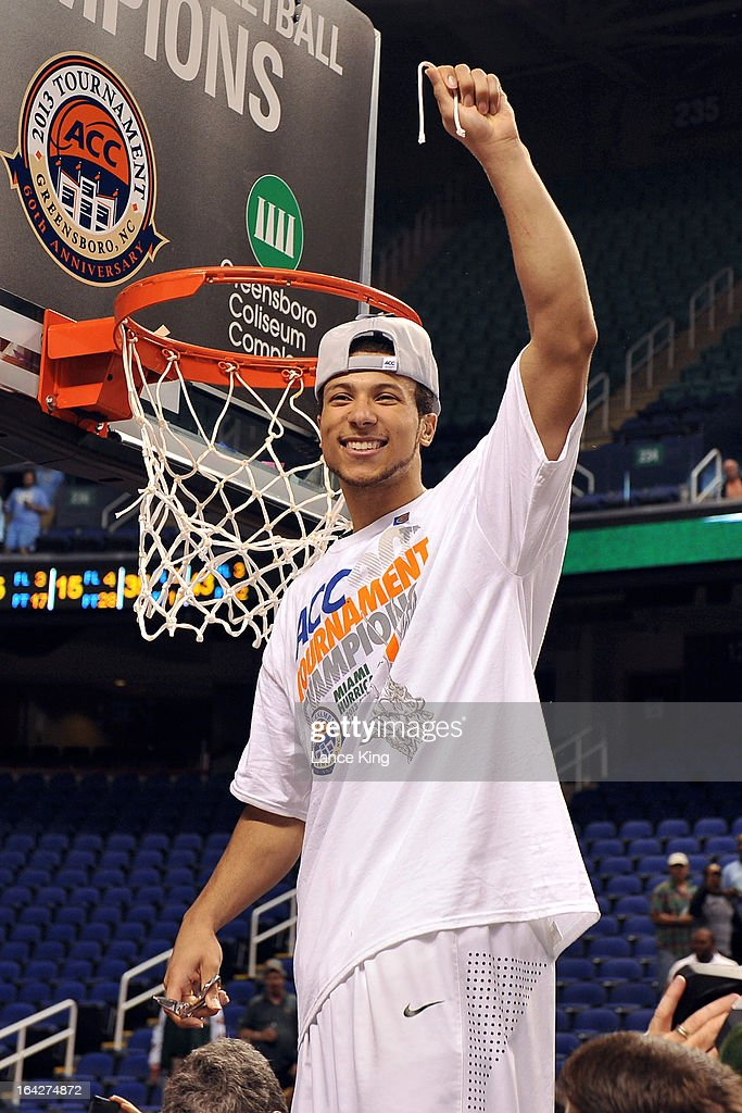 Trey McKinney Jones #4 of the Miami Hurricanes cuts part of a net following their 88-77 victory against the North Carolina Tar Heels during the finals of the 2013 Men's ACC Tournament at the Greensboro Coliseum on March 17, 2013 in Greensboro, North Carolina.