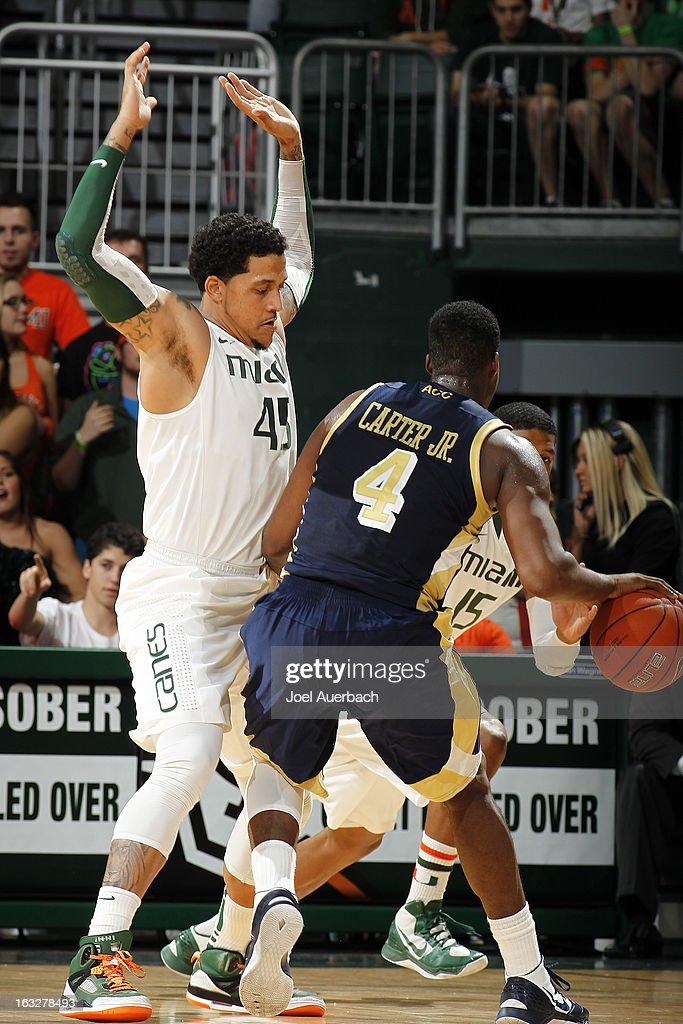 Trey McKinney Jones #4 of the Miami Hurricanes defends against Robert Carter, Jr. #4 of the Georgia Tech Yellow Jackets on March 6, 2013 at the BankUnited Center in Coral Gables, Florida.