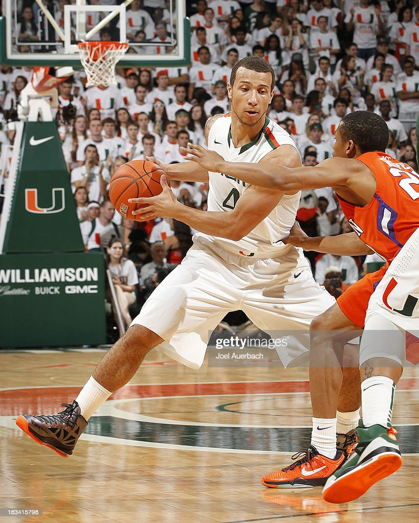 Trey McKinney Jones #4 of the Miami Hurricanes dribbles the ball against Jordan Roper #20 of the Clemson Tigers on March 9, 2013 at the BankUnited Center in Coral Gables, Florida.
