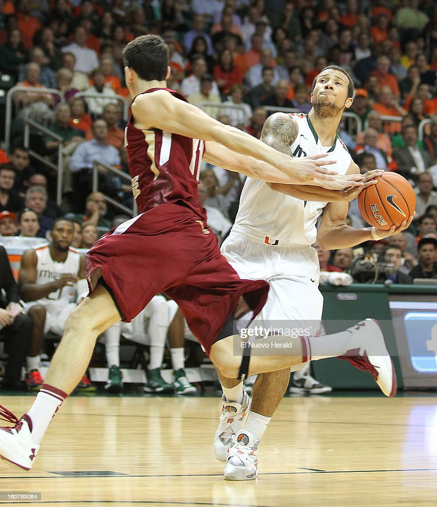 Trey McKinney Jones of the Miami Hurricanes drives to the basket against Danny Rubin, left, of the Boston College Eagles during the second half at the BankUnited Center in Miami, Florida, Tuesday, February 5, 2013. The Miami Hurricanes defeated the Boston College Eagles 72-50.