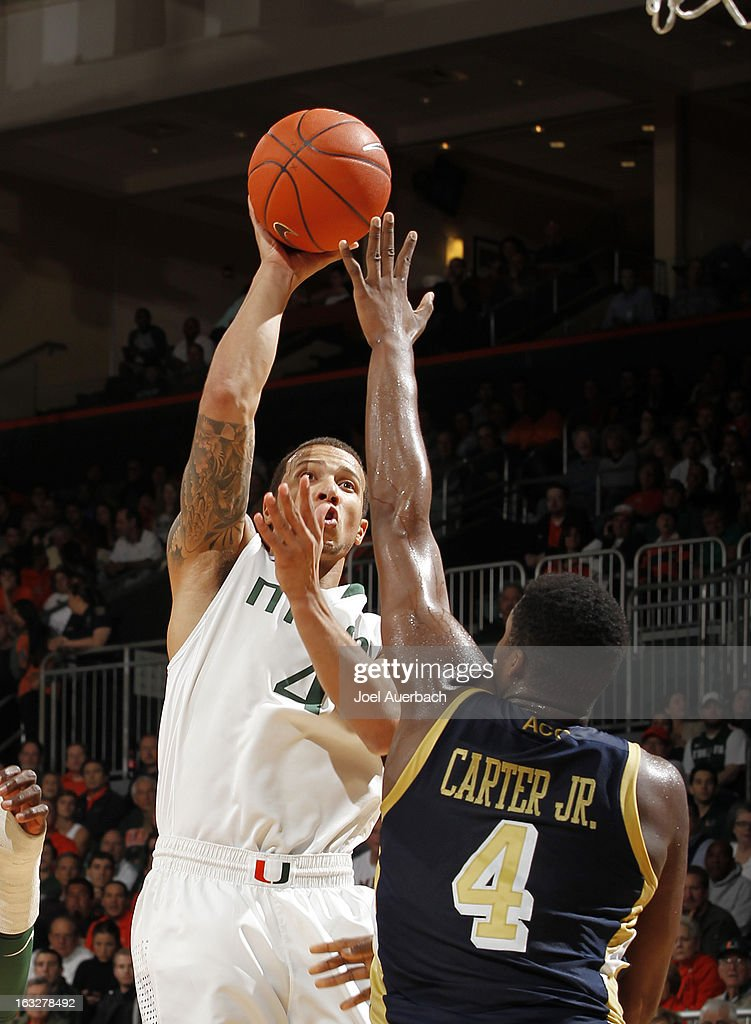 Trey McKinney Jones #4 of the Miami Hurricanes goes to the basket against Robert Carter, Jr. #4 of the Georgia Tech Yellow Jackets on March 6, 2013 at the BankUnited Center in Coral Gables, Florida.