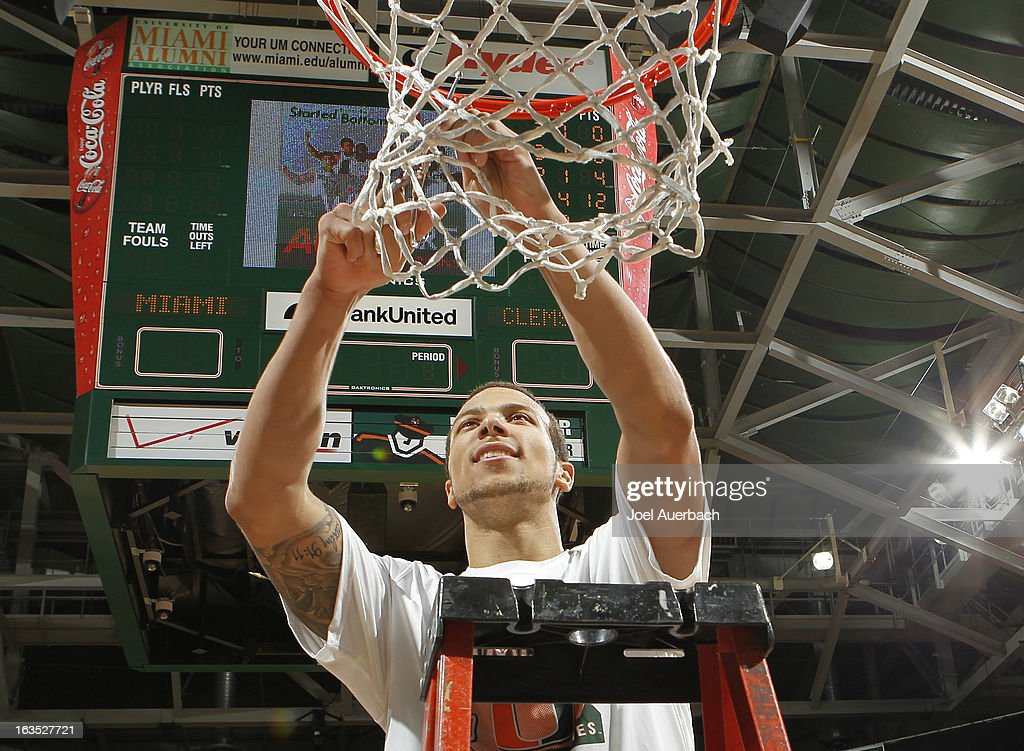Trey McKinney Jones #4 of the Miami Hurricanes helps cut down the net after the game against the Clemson Tigers on March 9, 2013 at the BankUnited Center in Coral Gables, Florida. The Hurricanes defeated the Tigers 62-49 and won the Atlantic Coast Conference Championship.