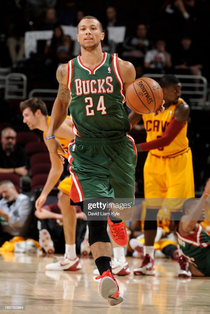 <a gi-track='captionPersonalityLinkClicked' href=/galleries/search?phrase=Trey+McKinney+Jones&family=editorial&specificpeople=8624313 ng-click='$event.stopPropagation()'>Trey McKinney Jones</a> #24 of the Milwaukee Bucks brings the ball up court against the Cleveland Cavaliers at The Quicken Loans Arena on October 8, 2013 in Cleveland, Ohio.