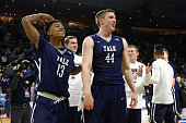 Trey Phills and Sam Downey of the Yale Bulldogs celebrate defeating the Baylor Bears 7975 during the first round of the 2016 NCAA Men's Basketball...