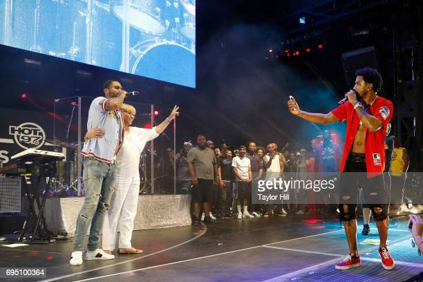 Trey Songz takes a photo of Dave East and his mother during the 2017 Hot 97 Summer Jam at MetLife Stadium on June 11 2017 in East Rutherford New...