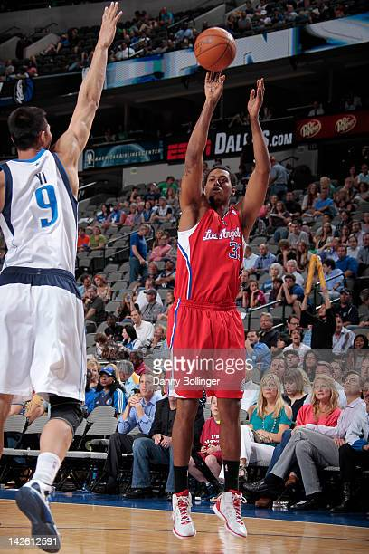 Trey Thompkins of the Los Angeles Clippers takes a jump shot against Yi Jianlian of the Dallas Mavericks on April 2 2012 at the American Airlines...