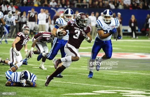Trey Williams of the Duke Blue Devils carries the ball against the Texas AM Aggies during the ChickFilA Bowl at the Georgia Dome on December 31 2013...