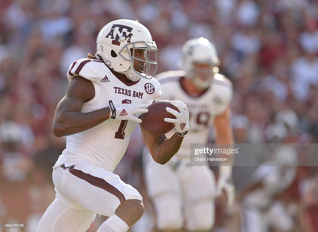 Trey Williams #3 of the Texas A&M Aggies runs against the South Carolina Gamecocks during their game at Williams-Brice Stadium on August 28, 2014 in Columbia, South Carolina.