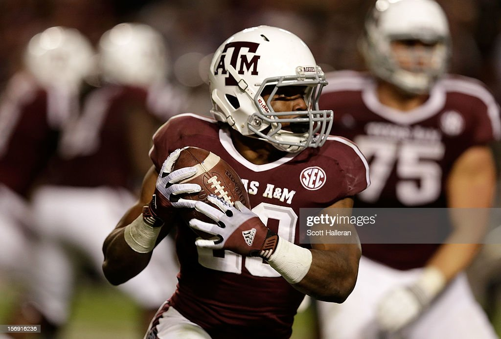 Trey Williams #20 of the Texas A&M Aggies runs upfield during their game against the Missouri Tigers at Kyle Field on November 24, 2012 in College Station, Texas.