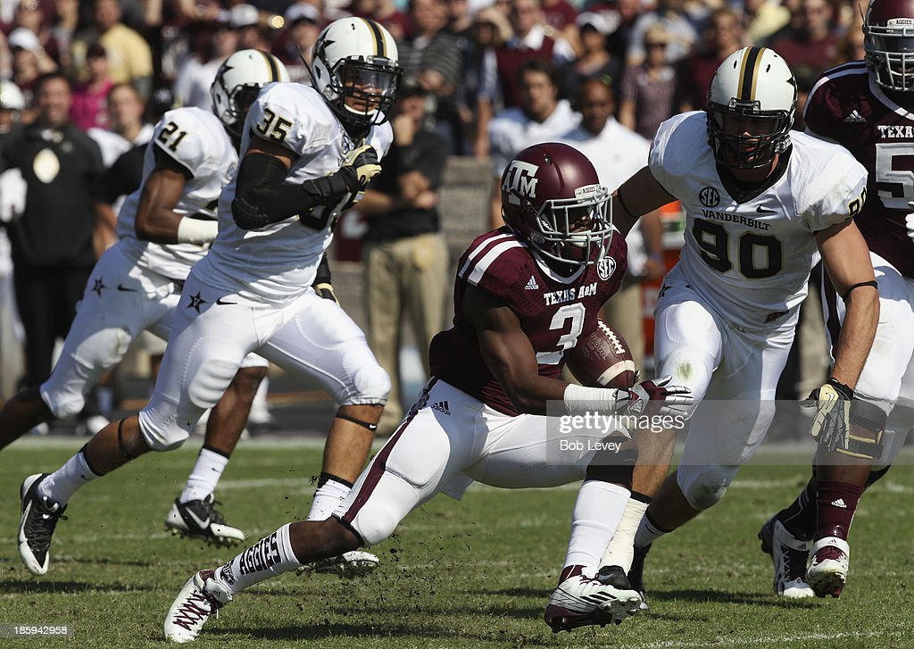 Trey Williams #3 of the Texas A&M Aggies rushes in the first quarter against the Vanderbilt Commodores as Walker May #90 of the Vanderbilt Commodores pursues at Kyle Field on October 26, 2013 in College Station, Texas.