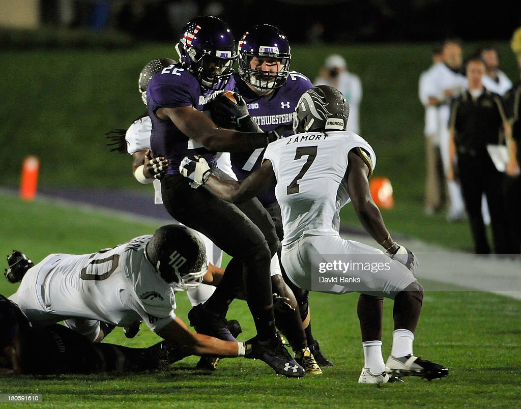 Treyvon Green #22 of the Northwestern Wildcats is tackled by Ronald Zamort #7 of the Western Michigan Broncos during the first quarter on September 14, 2013 at Ryan Field in Evanston, Illinois.