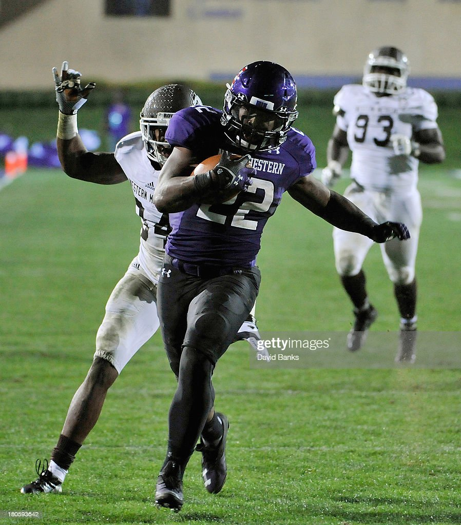 Treyvon Green #22 of the Northwestern Wildcats runs for a touchdown against the Western Michigan Broncos during the fourth quarter on September 14, 2013 at Ryan Field in Evanston, Illinois. The Northwestern Wildcats defeated the Western Michigan Broncos 38-17.