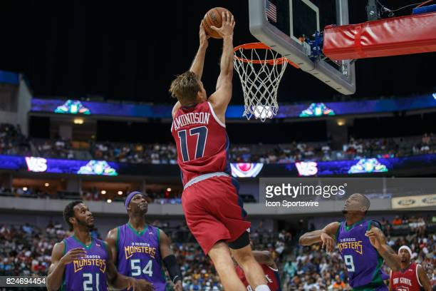 Tri State forward Lou Amundsen goes up for a dunk over 3 Headed Monsters players Kareem Rush Kwame Brown and Rashard Lewis during the Big3 basketball...