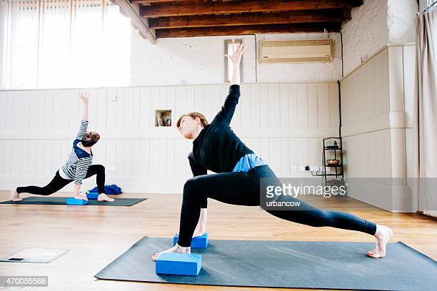 Triangle position, Utthita Trikonasana, Yoga class, exercise studio