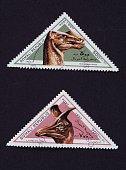 Triangular postage stamps from the Dinosaur series depicting Kritosaurus and Lambeosaurus Somalia 20th century Somalia