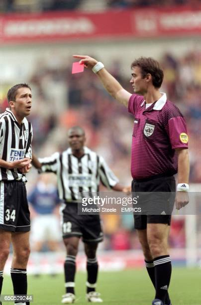Triantafilos Macheridis of PAOK Salonika is shown the red card by referee Kim Milton Neilsen in the opening minutes of the game for two yellow card...