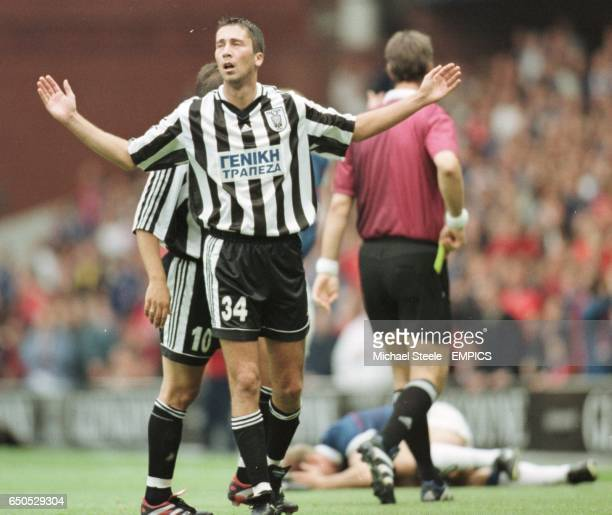 Triantafilos Macheridis of PAOK Salonika shows his disgust after being shown the yellow card by referee Kim Milton Nielsen for a reckless challenge...