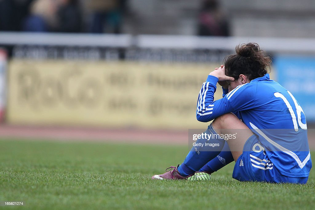 Triantafyllia Kyriazi of Greece reacts after losing the Women's UEFA U19 Euro Qualification match between U19 Germany and U19 Greece at Sportzentrum Sued on April 6, 2013 in Kirchheim, Germany.