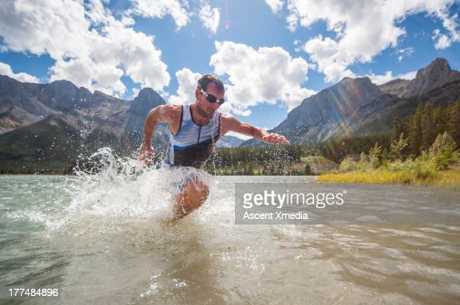 Triathelete charges out of mountain lake, on race