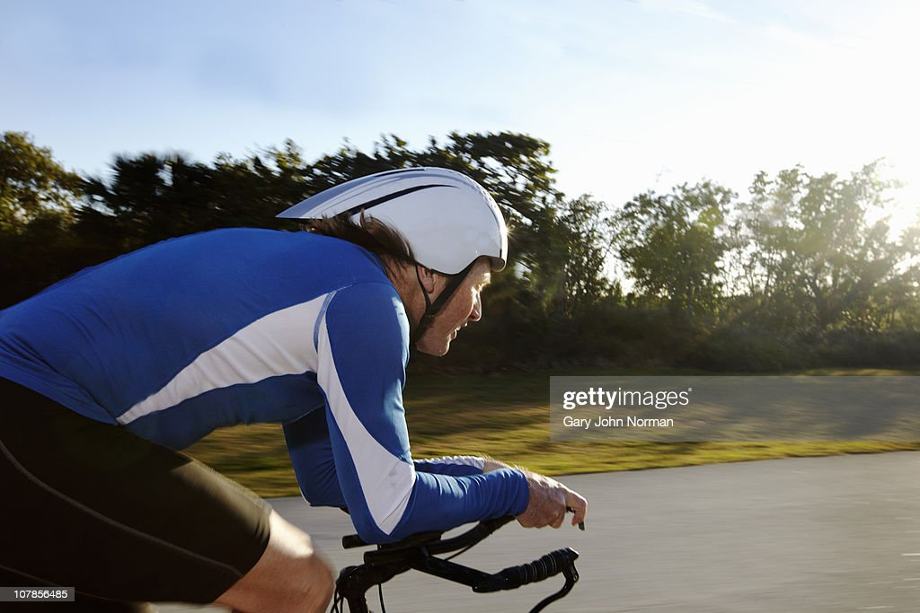 triathlete riding on bicycle : Stock Photo
