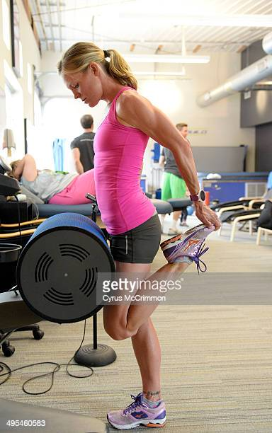 Triathlete Sarah Bay uses the vibrating Swisswing to loosen her leg muscles at Denver Sports Recovery 2241 W 29th Ave on Friday May 30 2014 The...