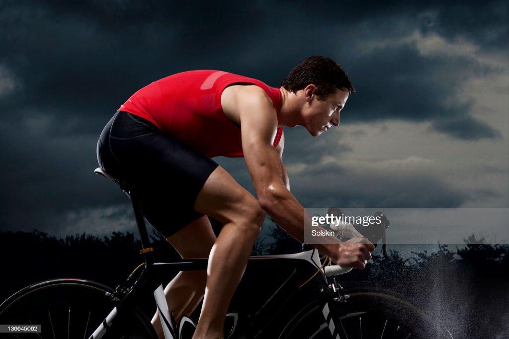 Triathlete training on cycle : Stock Photo