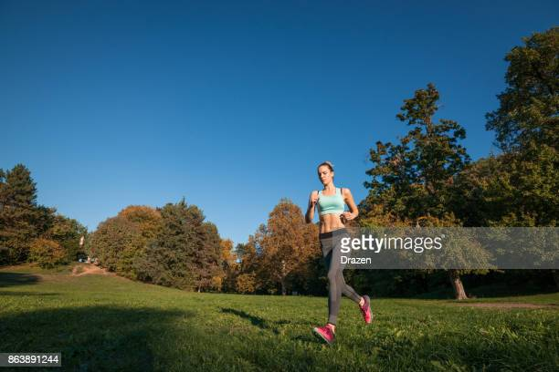 Triathlete woman jogging in woods