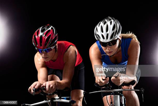 triathletes competing on bikes