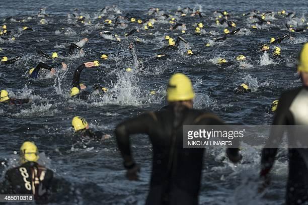Triathletes take part in the 3800 m swimming leg of the Ironman Copenhagen 2015 in Copenhagen on August 23 2015 AFP PHOTO / Scanpix Denmark / NIKOLAI...