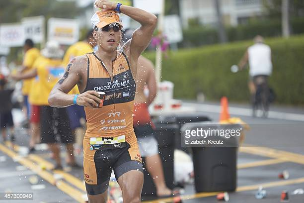 Ironman World Championship USA Apolo Ohno pours water over his head while in action during marathon leg of race Ohno finished the marathon in 33641...
