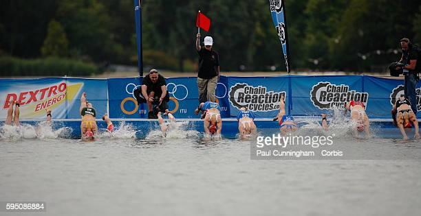 UK Triathlon Pool Stage Triathletes dive into the water at the start of the Elite Women ITU World Championship Dextro Energy Triathlon London 6...