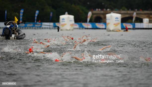 UK Triathlon Pool Stage Triathletes in the water head back to the pontoon for the transition to the bike Elite Women ITU World Championship Dextro...