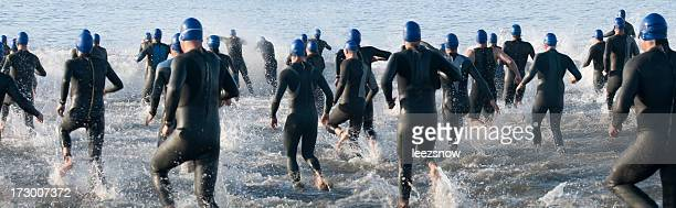 Triathlon Swimmers Running Into Ocean