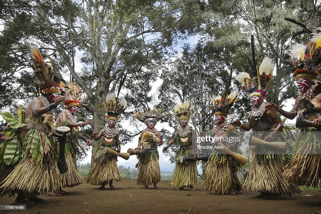 Tribal clan women sing, dance and play drums : Stock Photo