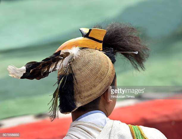 Tribal from Arunachal Pradesh wearing traditional head gear shouts slogans to implement Lokpal bill during a prayer meeting organised by Anna...