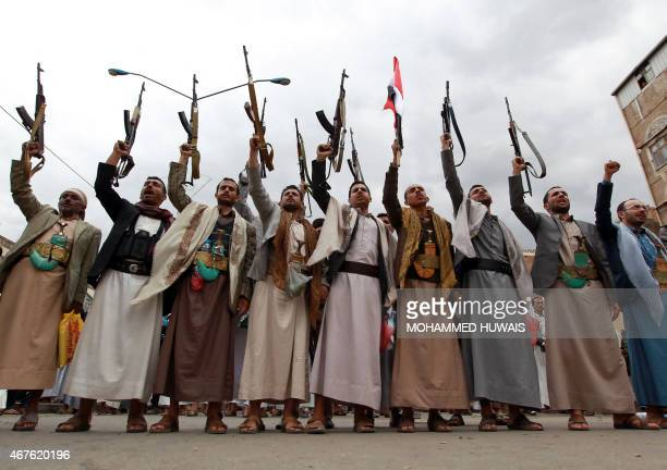 Tribal gunmen loyal to the Huthi movement brandish their weapons on March 26 2015 during a gathering in Sanaa to show support the Shiite Huthi...